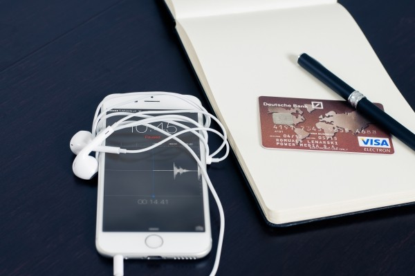 mobile-phone-and-credit-card-with-notebook-and-pen-on-table.jpg